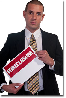Man Holding Foreclosure Sign